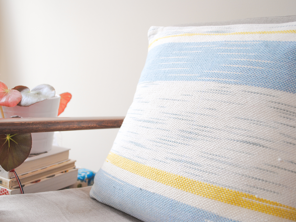 pillow-medium-square-cream-cloud-gold-chair-detail.png
