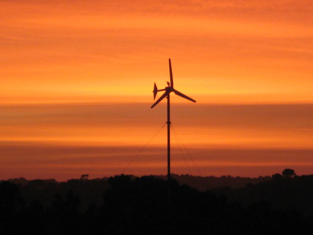 Wind Turbine at sunset.JPG