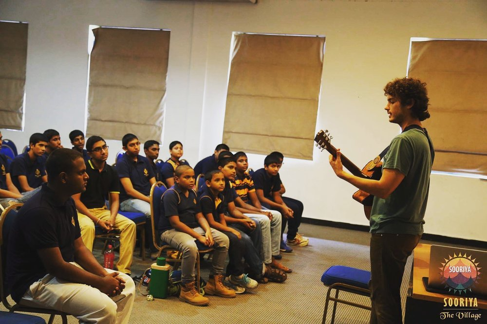 """Alper performing the original composition """"Squares of Heart"""" during a workshop with high school students in Colombo, Sri Lanka"""