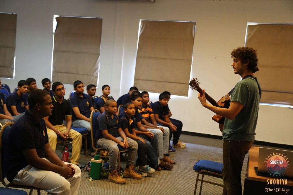 Teaching songwriting at Royal College in Colombo, Sri Lanka.