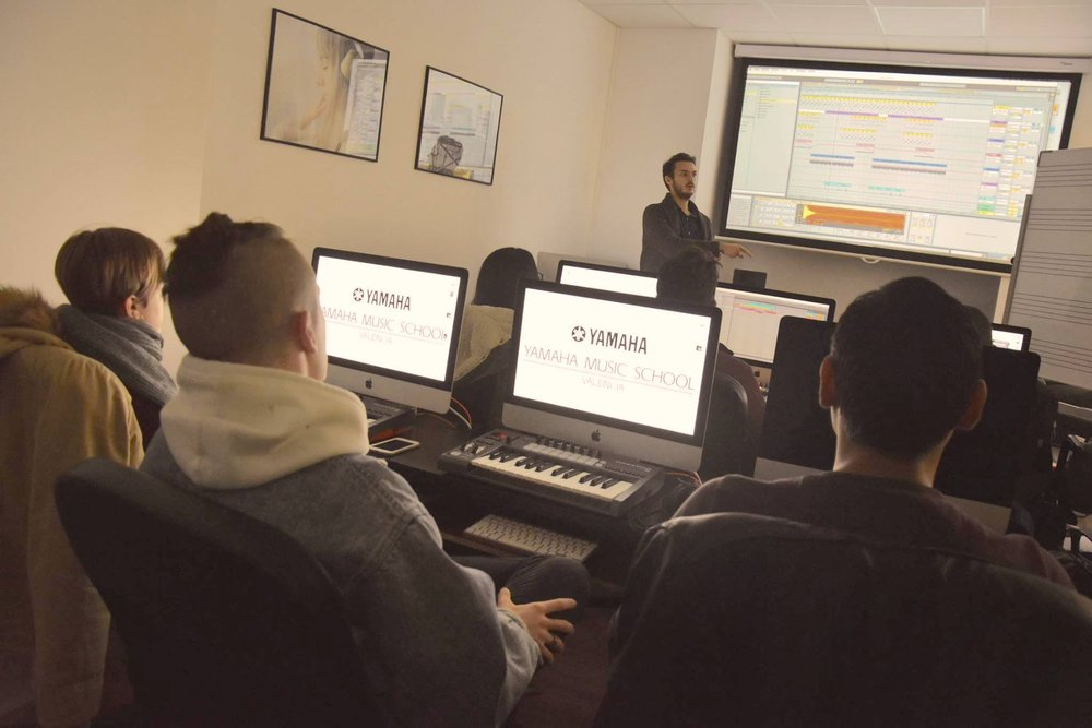 Alper explains music production techniques using Ableton Live.