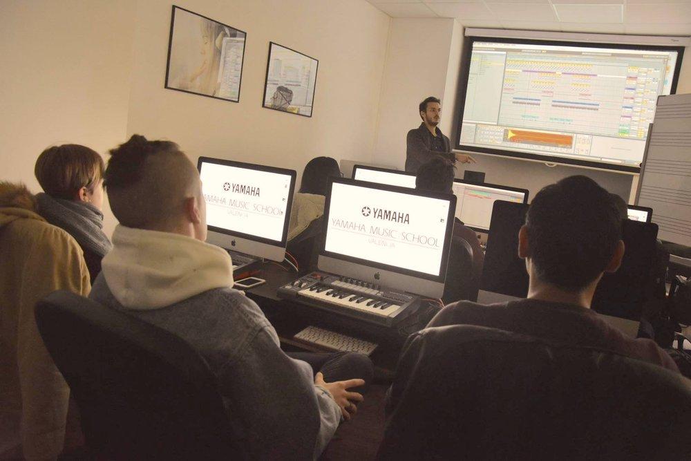 Alper explains music production techniques using Ableton Live.
