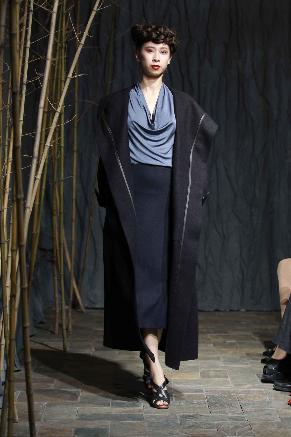 Generous midnight-blue coat with spiral-cut sleeves and enveloping hood//pigeon-blue batwing silkjersey top// midnight-blue asymmetric jersey flannel skirt