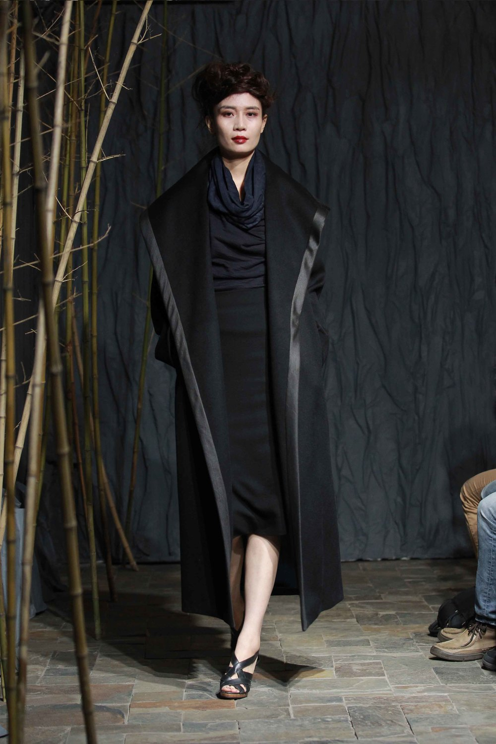 Generous black wool coat,overstitched with tea-silk trim// midnight-blue andblack hand-dyed woollen jersey top paired with tubular hood// black pencilskirt with leather trim