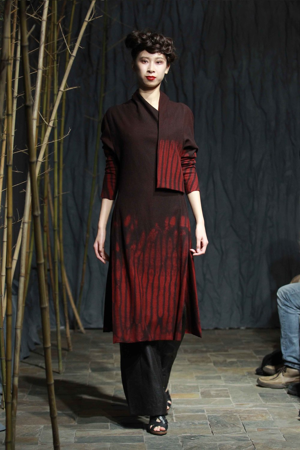 "Red hand-dyed jersey flannel tunic with triangular batwing sleeves, waisted at the back with smocked ""bark"" pleats"
