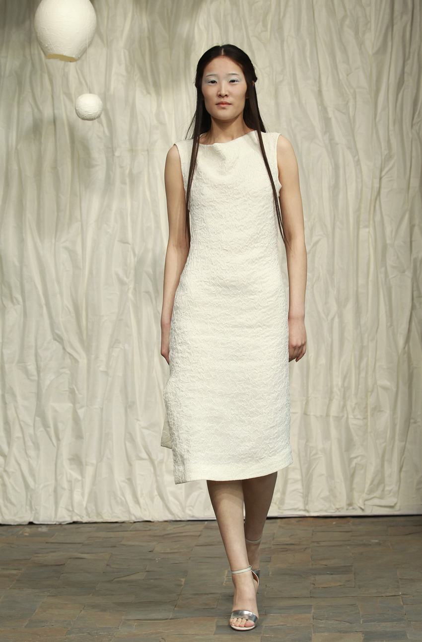 Fitted white crackle dress with asymmetric hemline