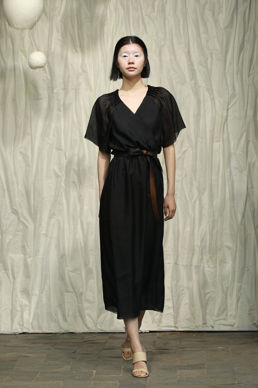 Black silk chiffon dress with puffy sleeves and darts