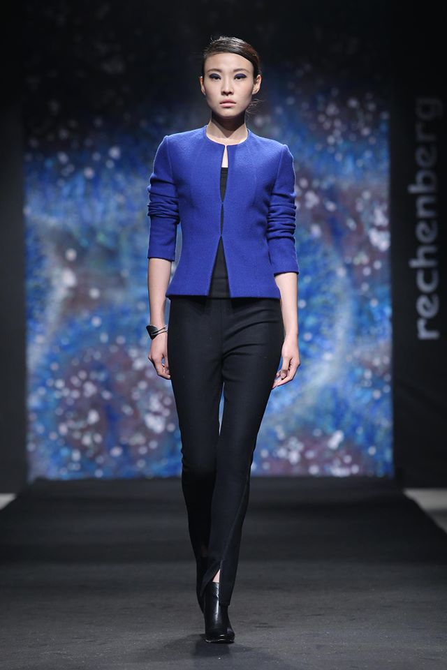 short cobalt blue jacket, black spiral cut pants with leather trim