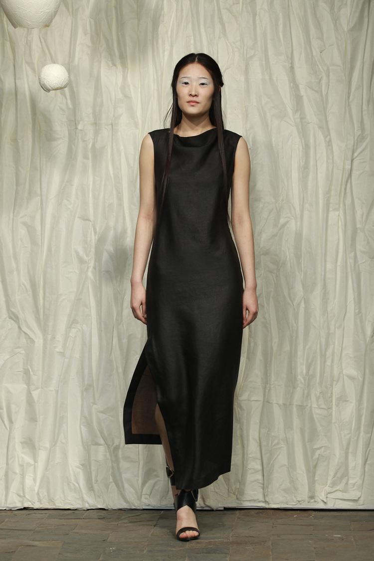 Fitted draped tea silk spiral cut dress with asymmetric hemline