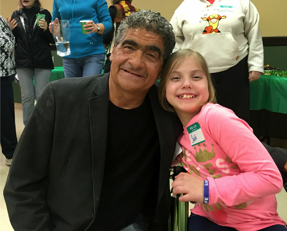 George Pastorina enjoys a happy moment with adaptive cyclist Sadie.