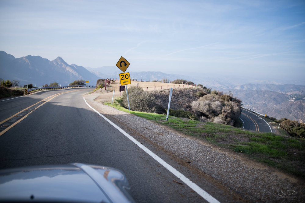 photo of a mountain bend while driving in a sports car honda s2000 malibu