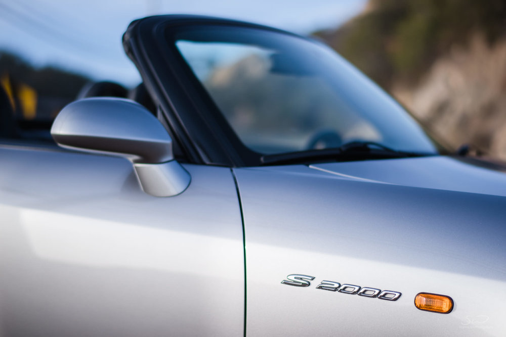 detail shot of the logo on a honda s2000 in malibu sunny california