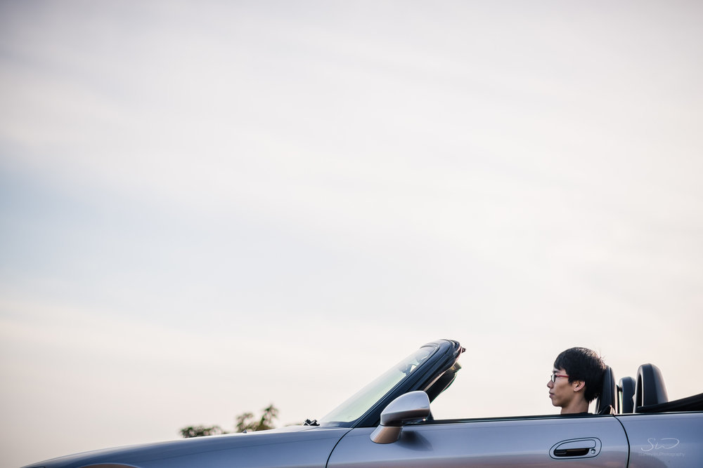 minimalist portrait of friend driving his honda s2000 in malibu california under blue skies