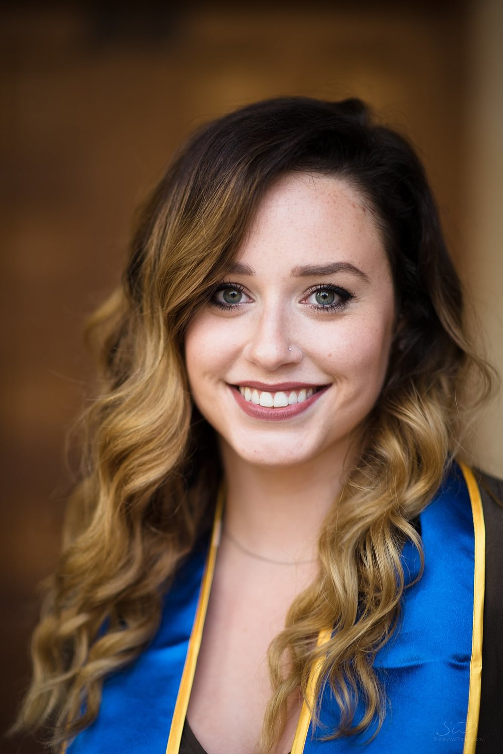beautiful graduation senior portrait of a white girl smiling at ucla in los angeles