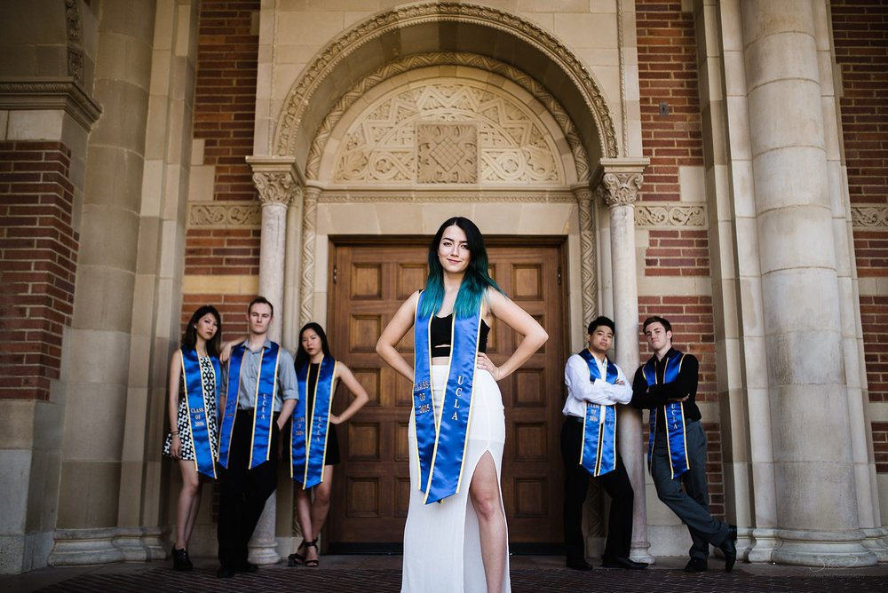 epic graduation senior portrait of a group of friends with a dominant posed girl in front in royce hall at ucla in los angeles