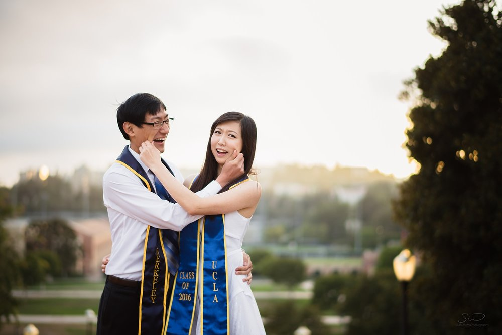 cute graduation senior portrait of a couple pinching each others cheeks at ucla in los angeles