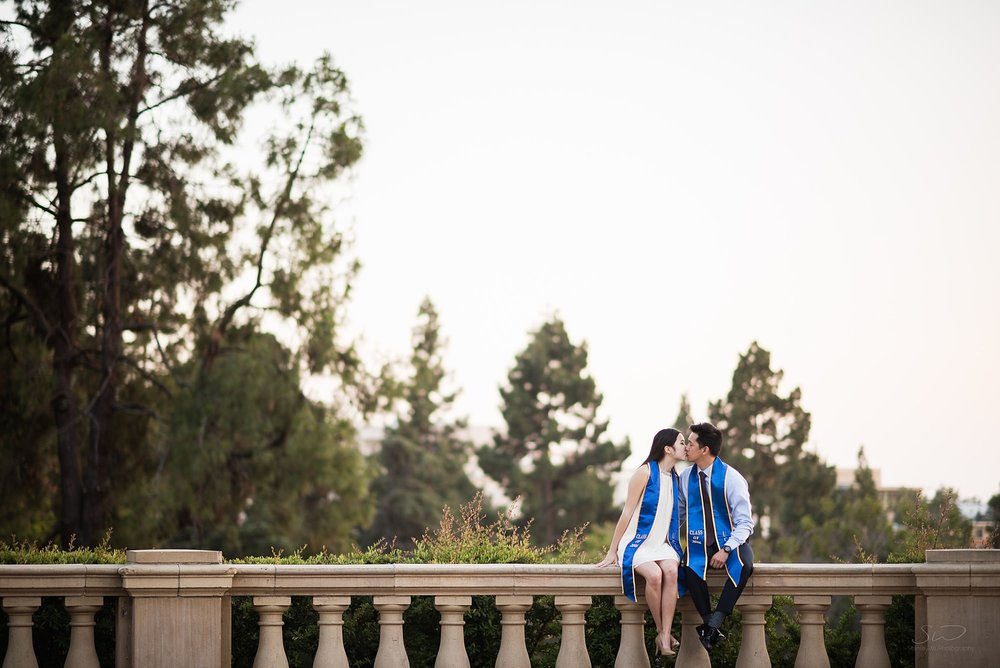 graduation senior minimalist portrait of a couple kissing at ucla in los angeles
