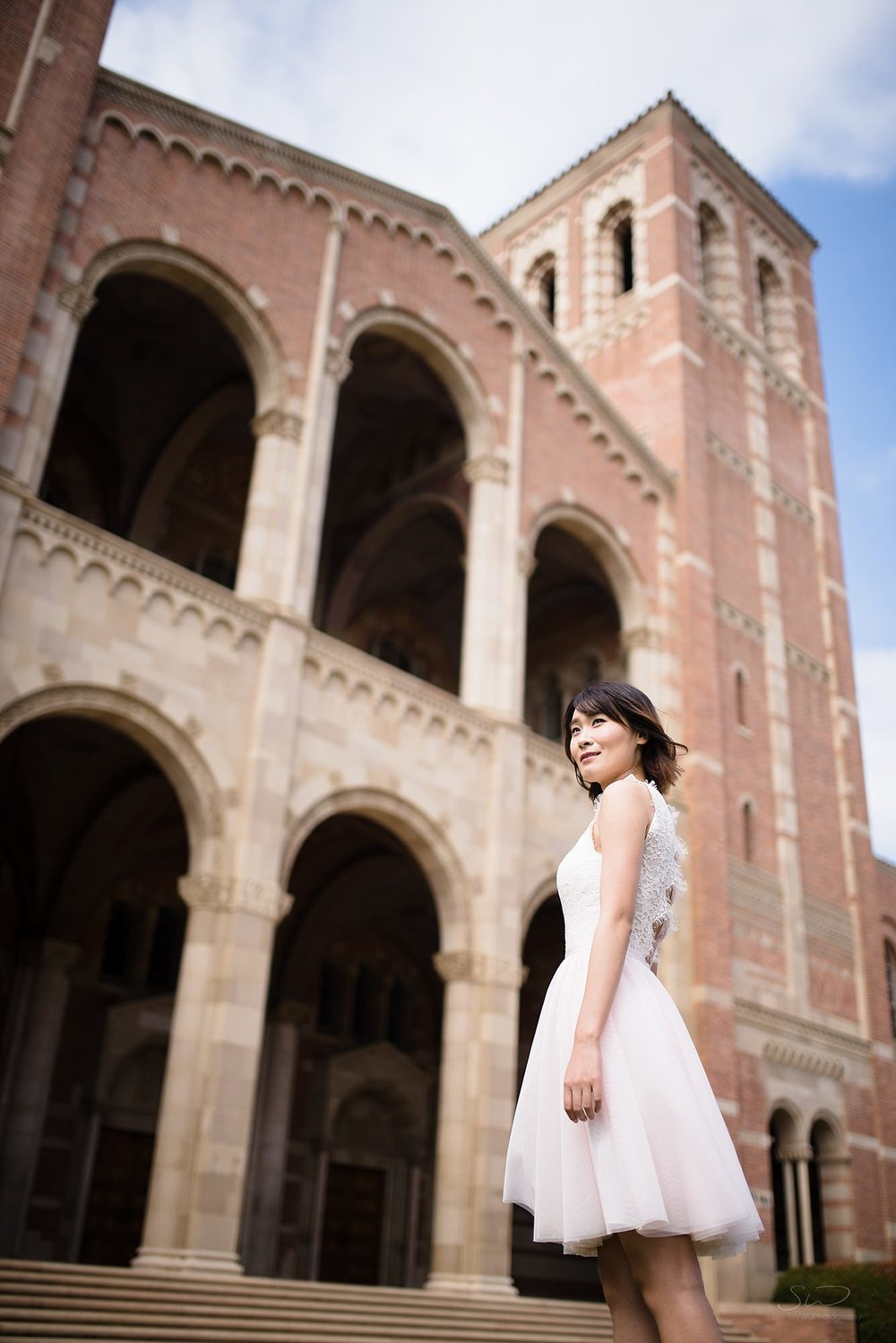 epic graduation senior portrait of a chinese girl looking up towards her future in front of royce hall at ucla in los angeles