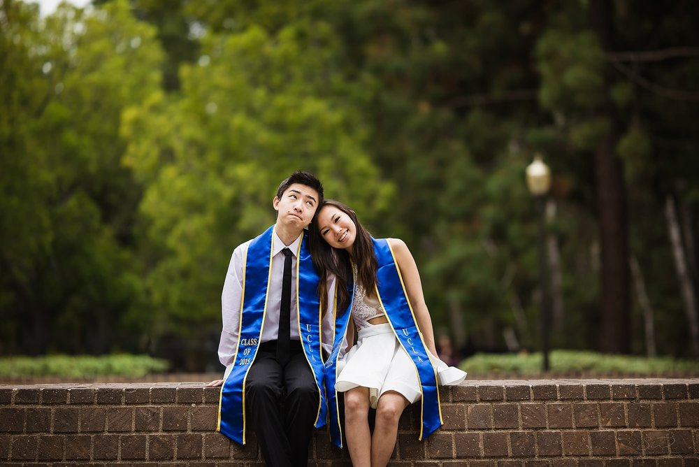 graduation senior portrait of a cute couple sitting at the inverted fountain at ucla in los angeles
