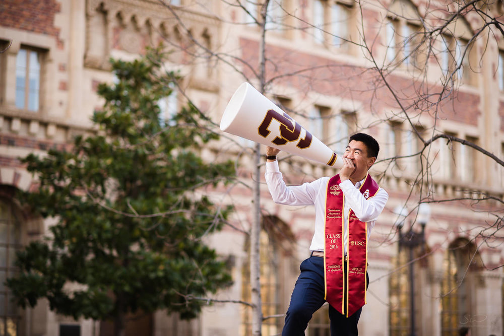 USC college senior graduate holding spirit team sports prop by Stanley Wu Photography | Portrait & Wedding Photographer serving Los Angeles, Orange County, and Southern California