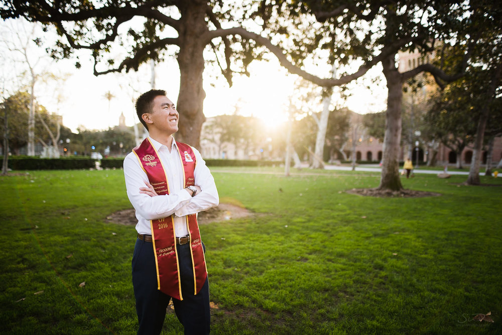 USC college senior graduate standing in front of grassy green background by Stanley Wu Photography | Portrait & Wedding Photographer serving Los Angeles, Orange County, and Southern California