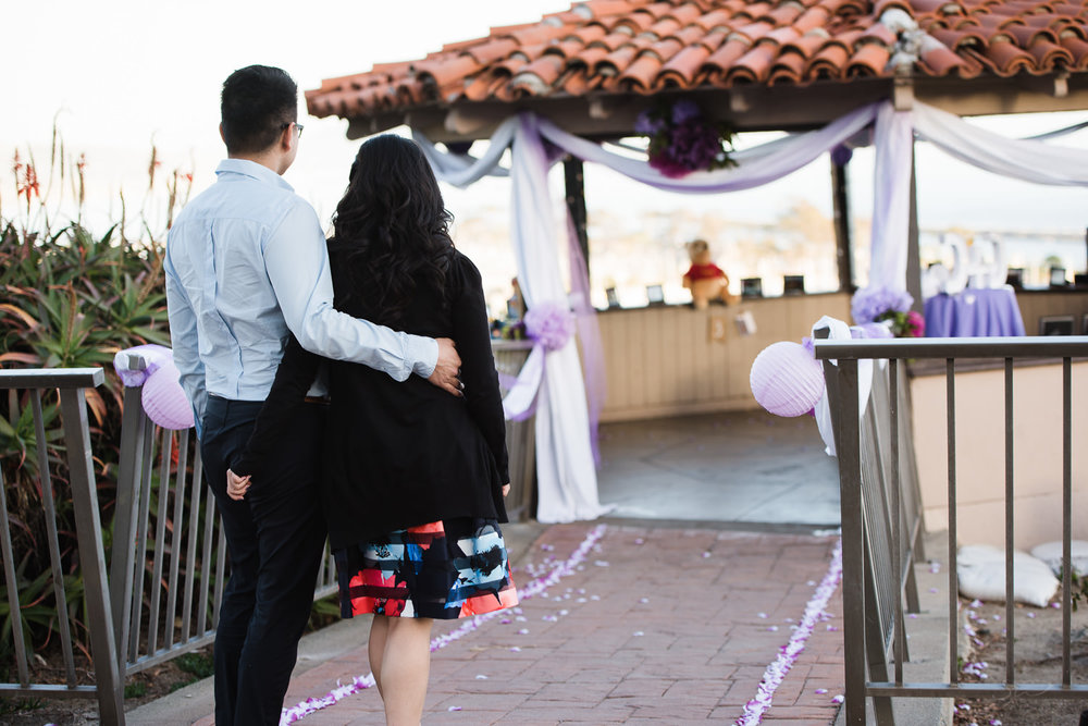 Going into the gazebo. Cliffside proposal & engagement in Dana Point | Stanley Wu Photography Portrait & Wedding Photographer | Los Angeles, Orange County, Southern California
