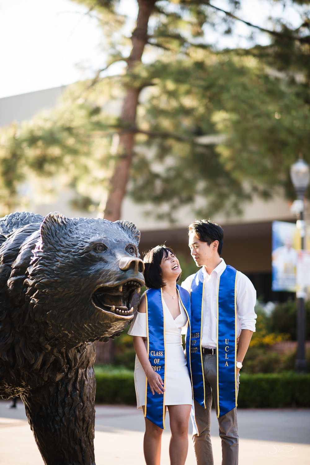 Copy of Copy of college seniors wearing 2017 sashes by the bruin bear  | Stanley Wu Photography | Los Angeles | Graduation Portraits | UCLA, USC, LMU, Pepperdine, CSULA, CSUN, CSULB, UCI, UCSD
