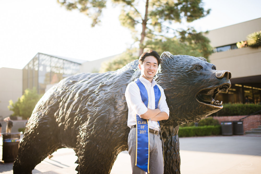 Copy of Copy of college senior wearing 2017 sash by the bruin bear  | Stanley Wu Photography | Los Angeles | Graduation Portraits | UCLA, USC, LMU, Pepperdine, CSULA, CSUN, CSULB, UCI, UCSD