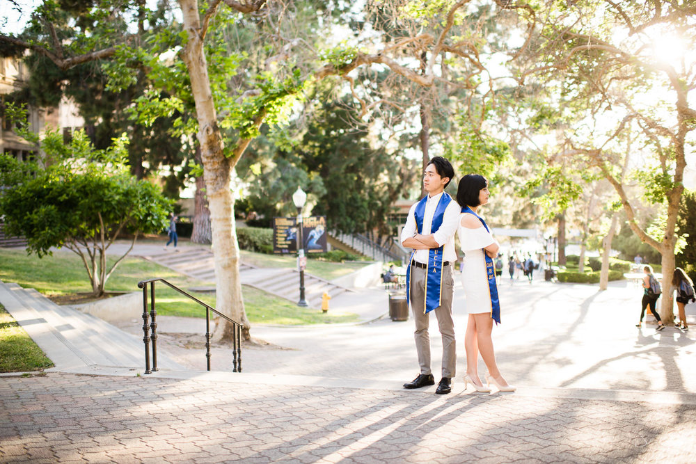 Copy of Copy of college senior couple posing together on top of stairs wearing 2017 sashes  | Stanley Wu Photography | Los Angeles | Graduation Portraits | UCLA, USC, LMU, Pepperdine, CSULA, CSUN, CSULB, UCI, UCSD