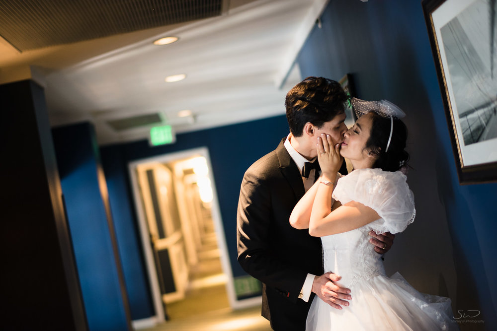 Hallway Kiss in Hotel Portofino Redondo Beach. Los Angeles and Orange County Engagement and Wedding Photographer.