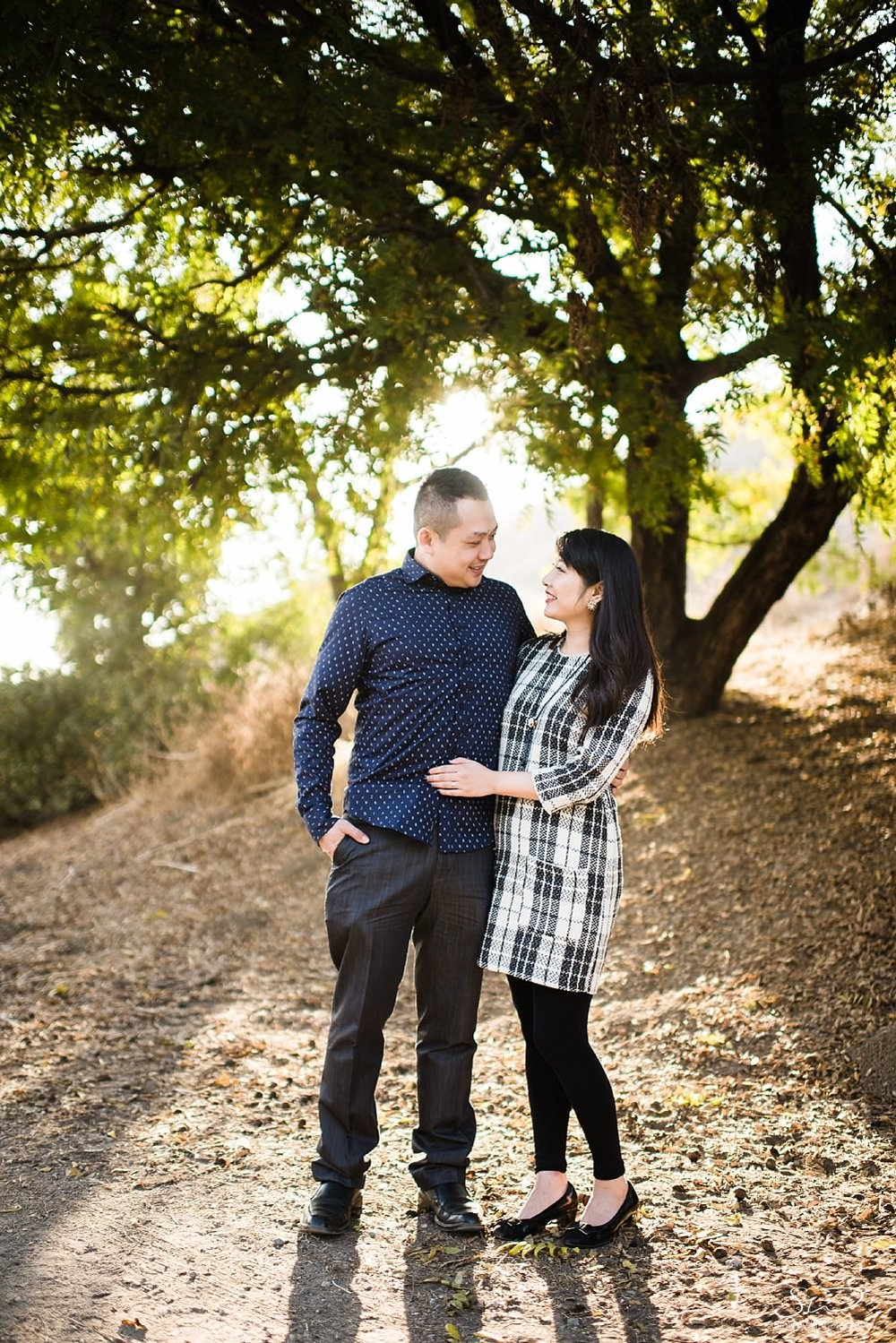 Couple smiling at each other | Ascot Hills Engagement – Portrait and Wedding Photography by Stanley Wu, based in Los Angeles