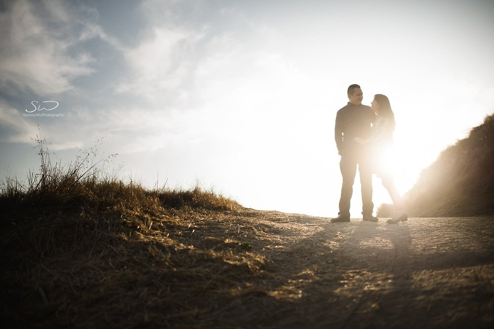 Epic silhouette shot of couple on a hill | Ascot Hills Engagement – Portrait and Wedding Photography by Stanley Wu, based in Los Angeles