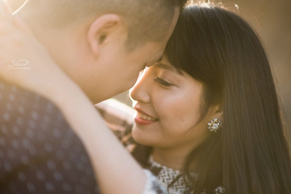 Sunlit close up shot of couple embracing | Ascot Hills Engagement – Portrait and Wedding Photography by Stanley Wu, based in Los Angeles