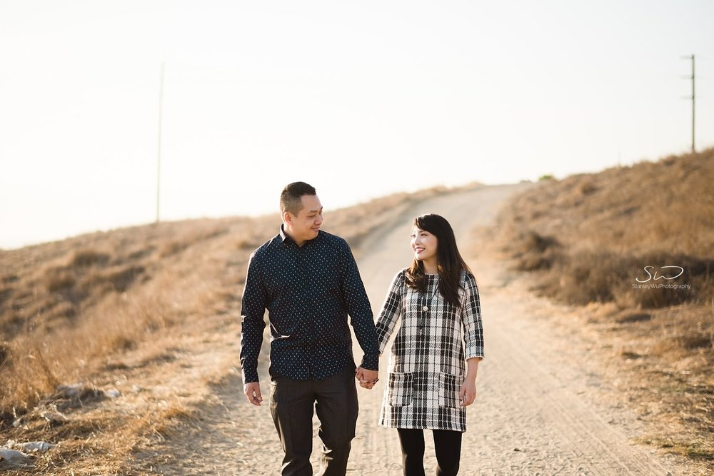 Couple walking on a hill | Ascot Hills Engagement – Portrait and Wedding Photography by Stanley Wu, based in Los Angeles