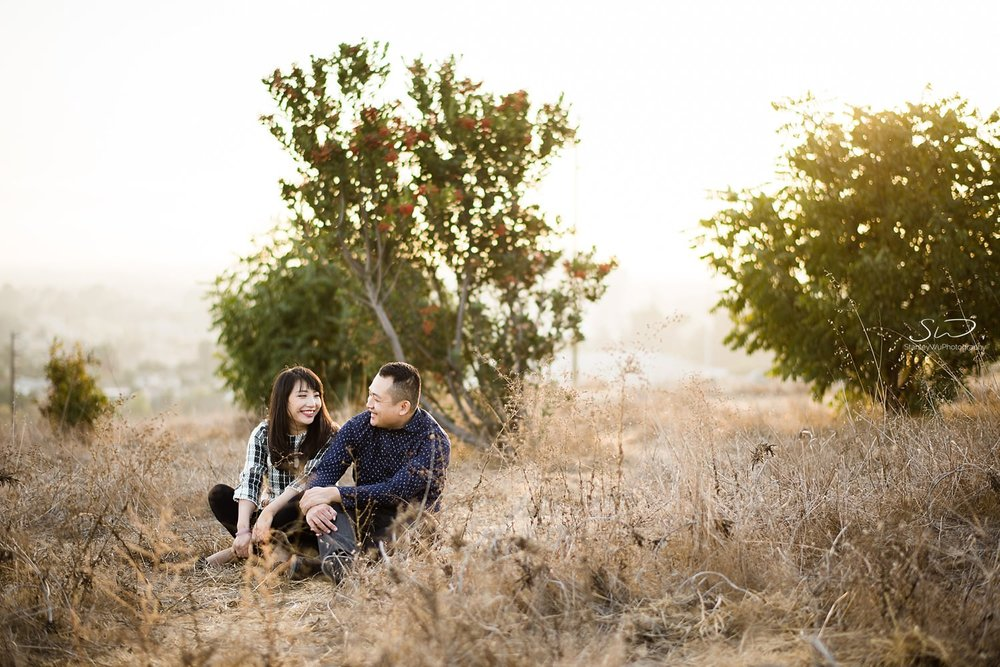 Portrait of couple sitting on grass by Stanley Wu, timeless and artistic portrait and wedding photographer based in Los Angeles.