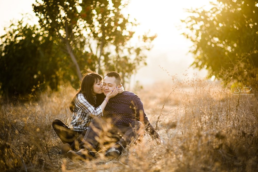 Couple kissing on the cheek by Stanley Wu, timeless and artistic portrait and wedding photographer based in Los Angeles.