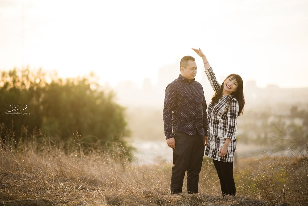 Couple comparing heights playfully by Stanley Wu, timeless and artistic portrait and wedding photographer based in Los Angeles.