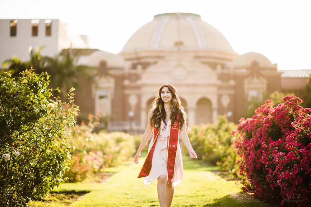 Girl walking through Rose Garden at USC. Best graduation portrait photography, Los Angeles.
