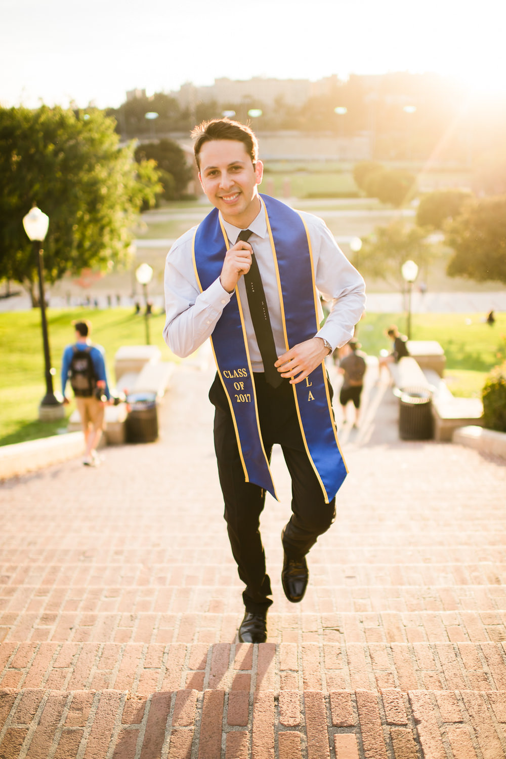 Senior walking up Janss Steps. Best graduation portrait photography, Los Angeles.