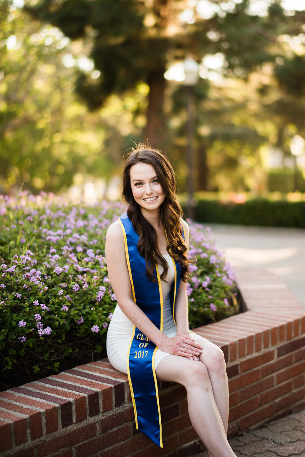 Smiling senior in nature at UCLA. Best graduation portrait photography, Los Angeles.