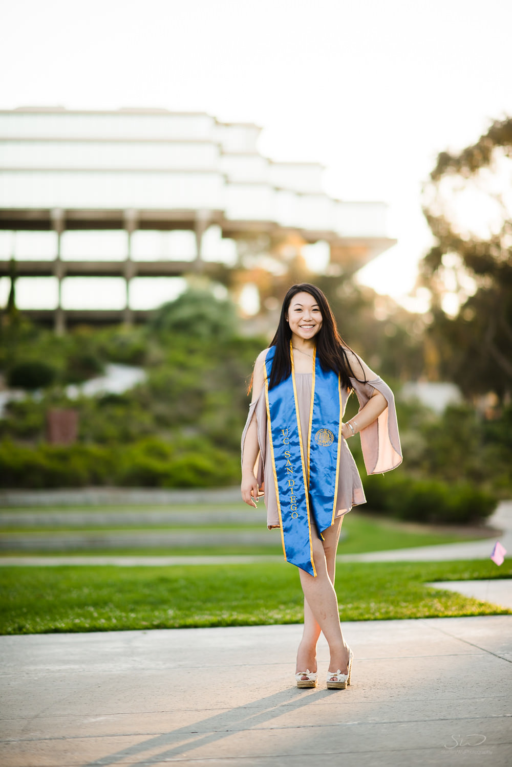 Posing in front of Geisel Library at UC San Diego UCSD. Best graduation portrait photography, Los Angeles.