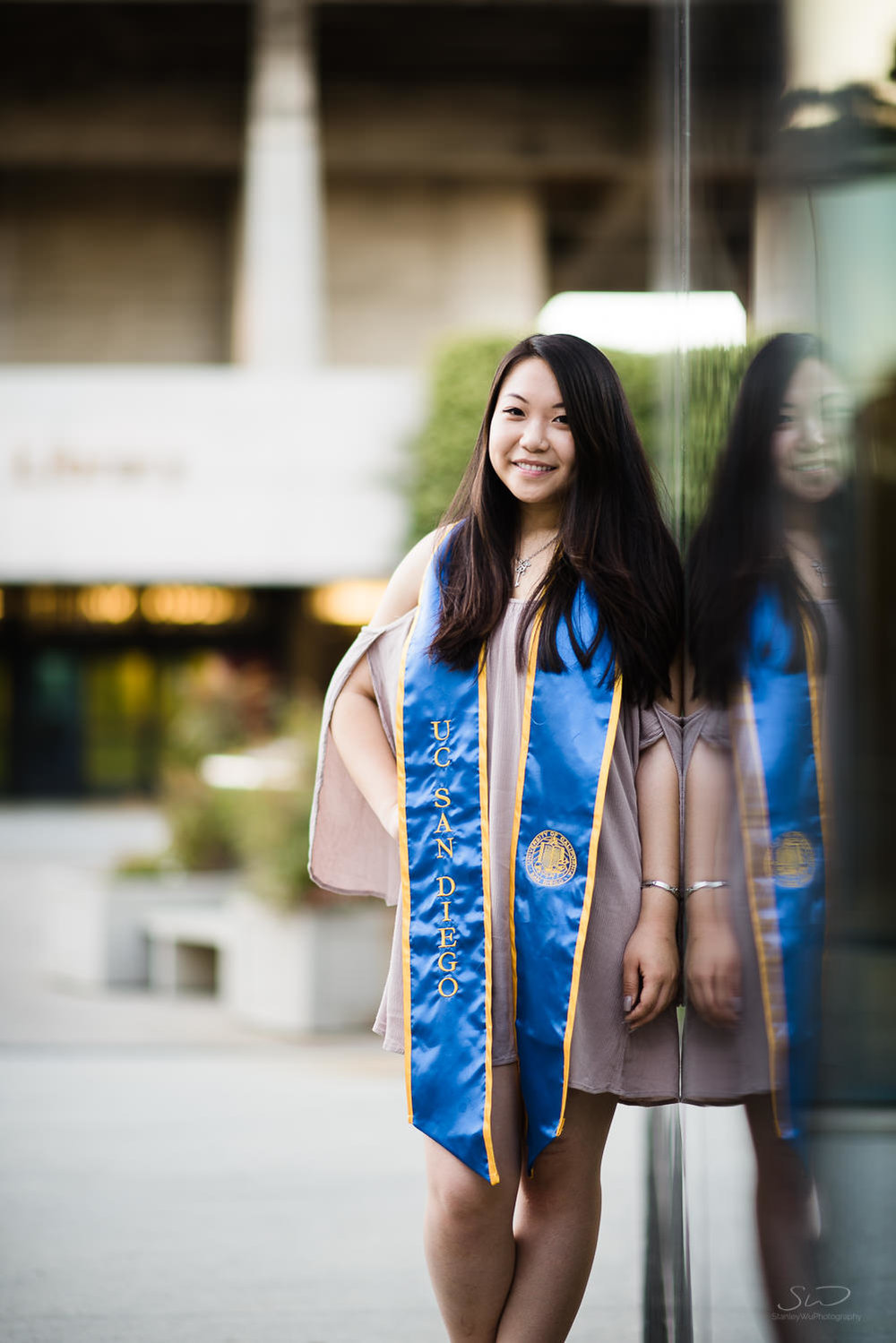 Posing in front of Geisel Library at UC San Diego. Best graduation portrait photography, Los Angeles.