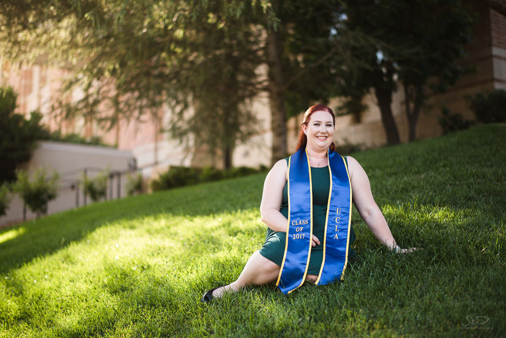Posing on grass. Best graduation portrait photography, Los Angeles.