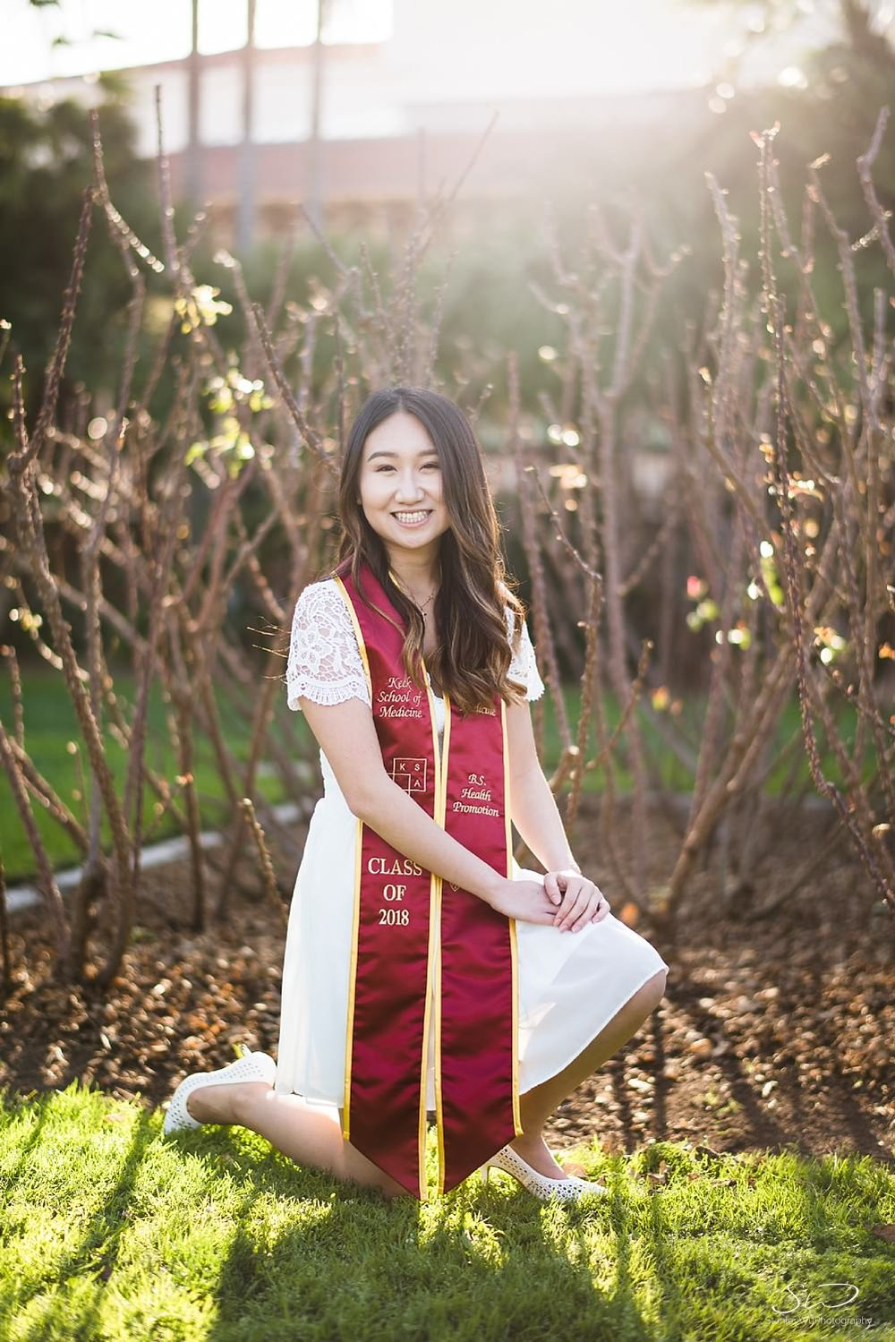 Senior wearing sash and white dress at Rose Garden at USC | Los Angeles Orange County Senior Portrait & Wedding Photographer