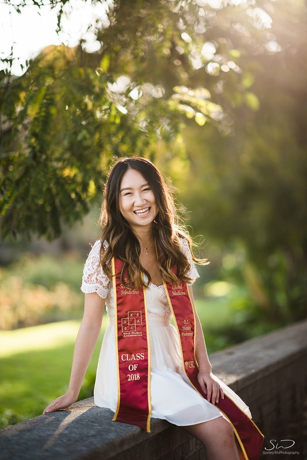 Laughing portrait and wearing graduation sash at the Rose Garden at USC | Los Angeles Orange County Senior Portrait & Wedding Photographer