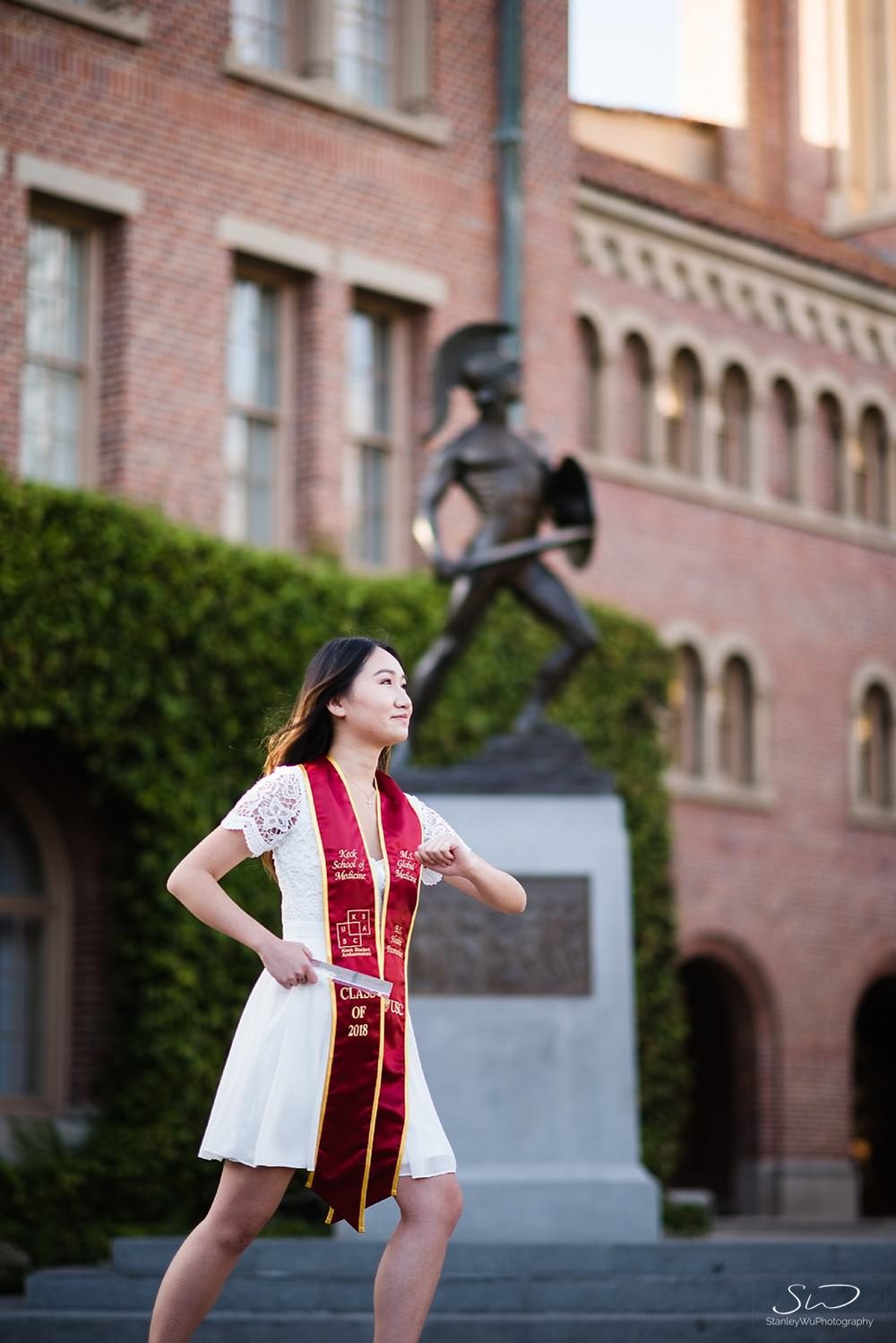 Posing with Tommy Trojan graduation photo at USC | Los Angeles Orange County Senior Portrait & Wedding Photographer