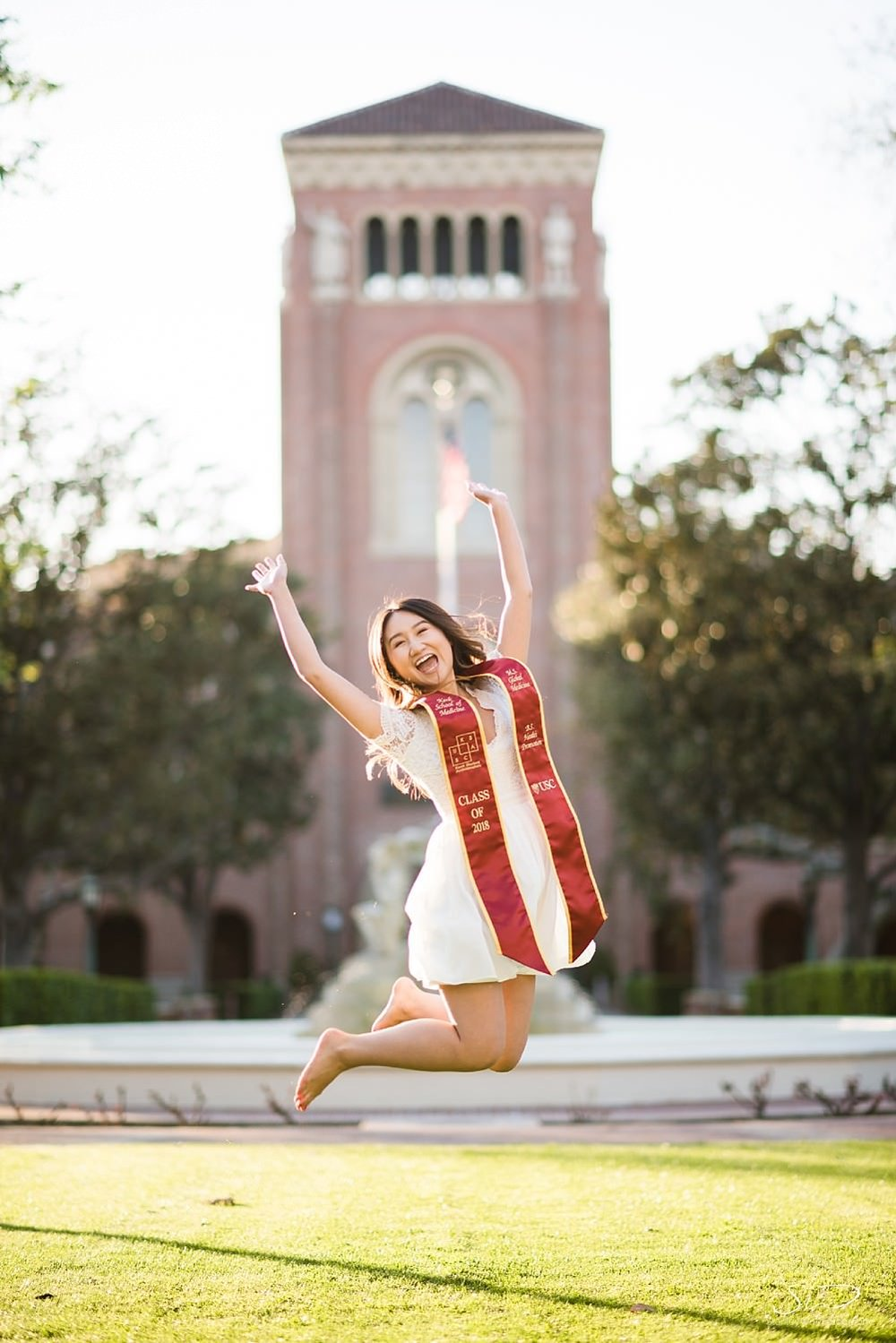 Jumping Portrait in front of Bovard Hall at USC | Los Angeles Orange County Senior Portrait & Wedding Photographer