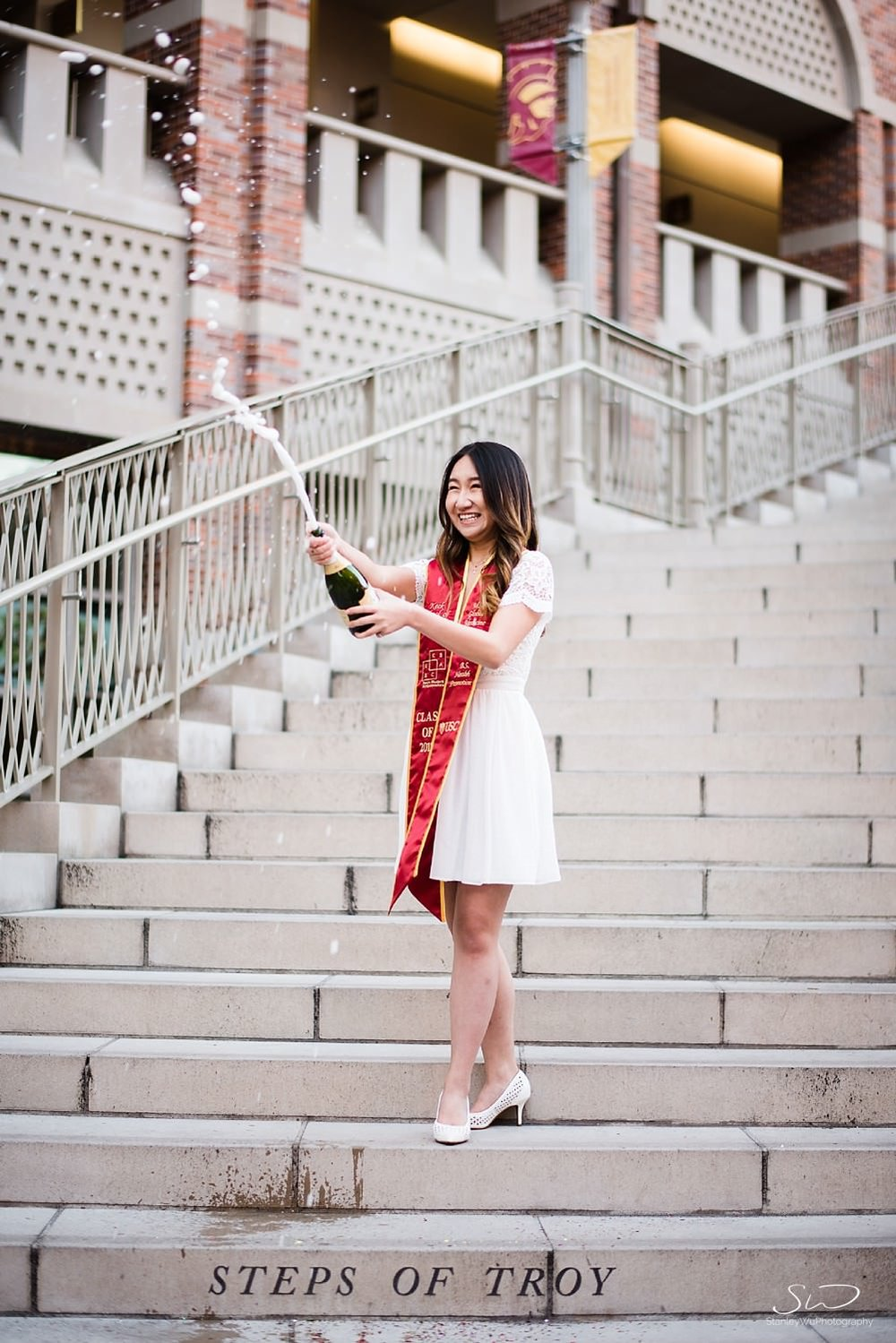 Champagne pop graduation photo at USC | Los Angeles Orange County Senior Portrait & Wedding Photographer