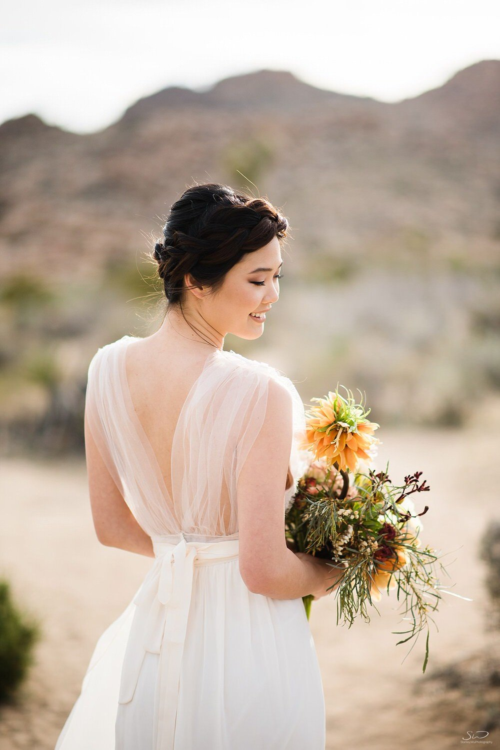 Bride with wedding bouquet in desert | Joshua Tree Desert Wedding & Engagement Inspiration