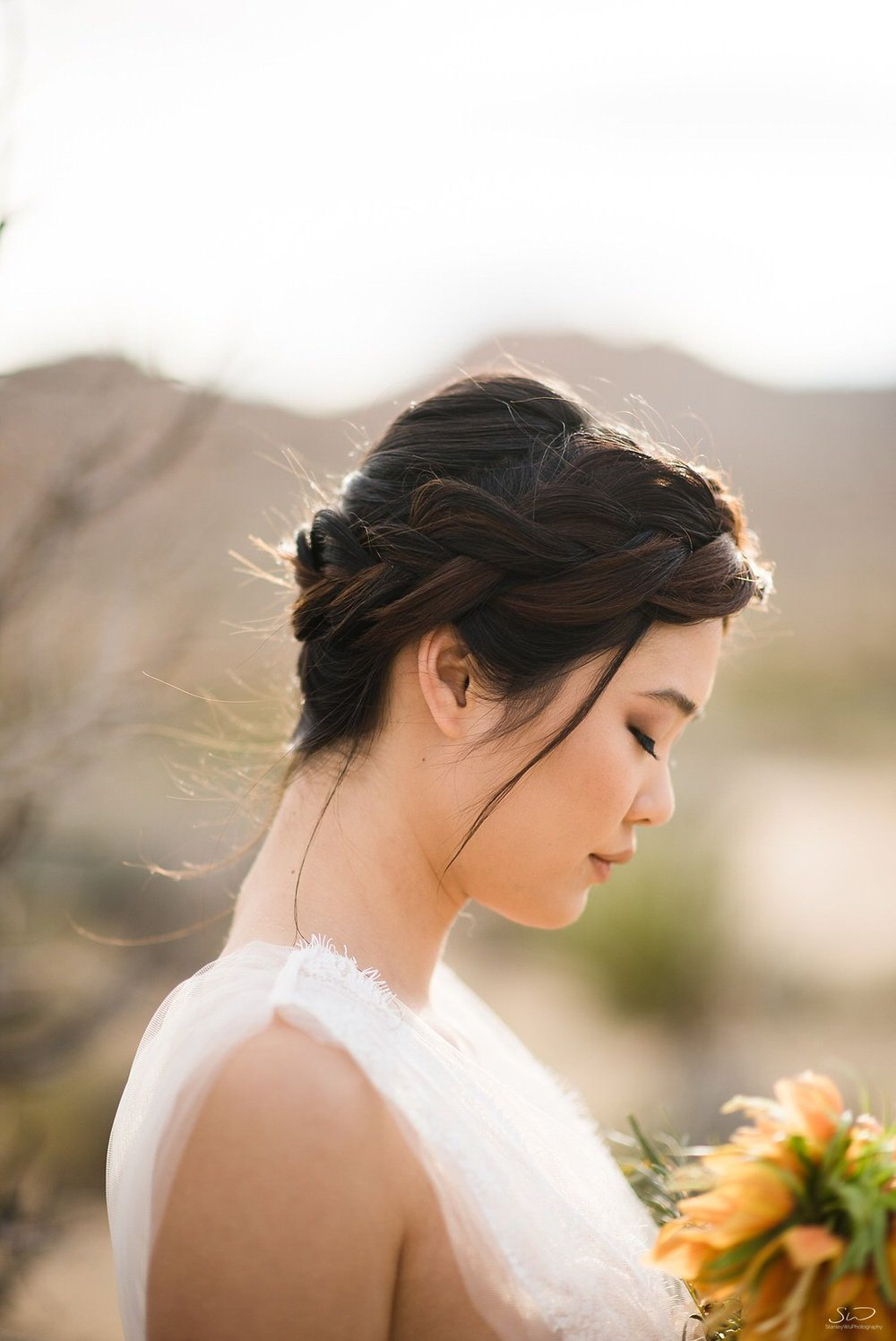 Profile shot of bride with desert flower bouquet | Joshua Tree Desert Wedding & Engagement Inspiration